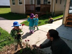 planting flowers Owen w Katie